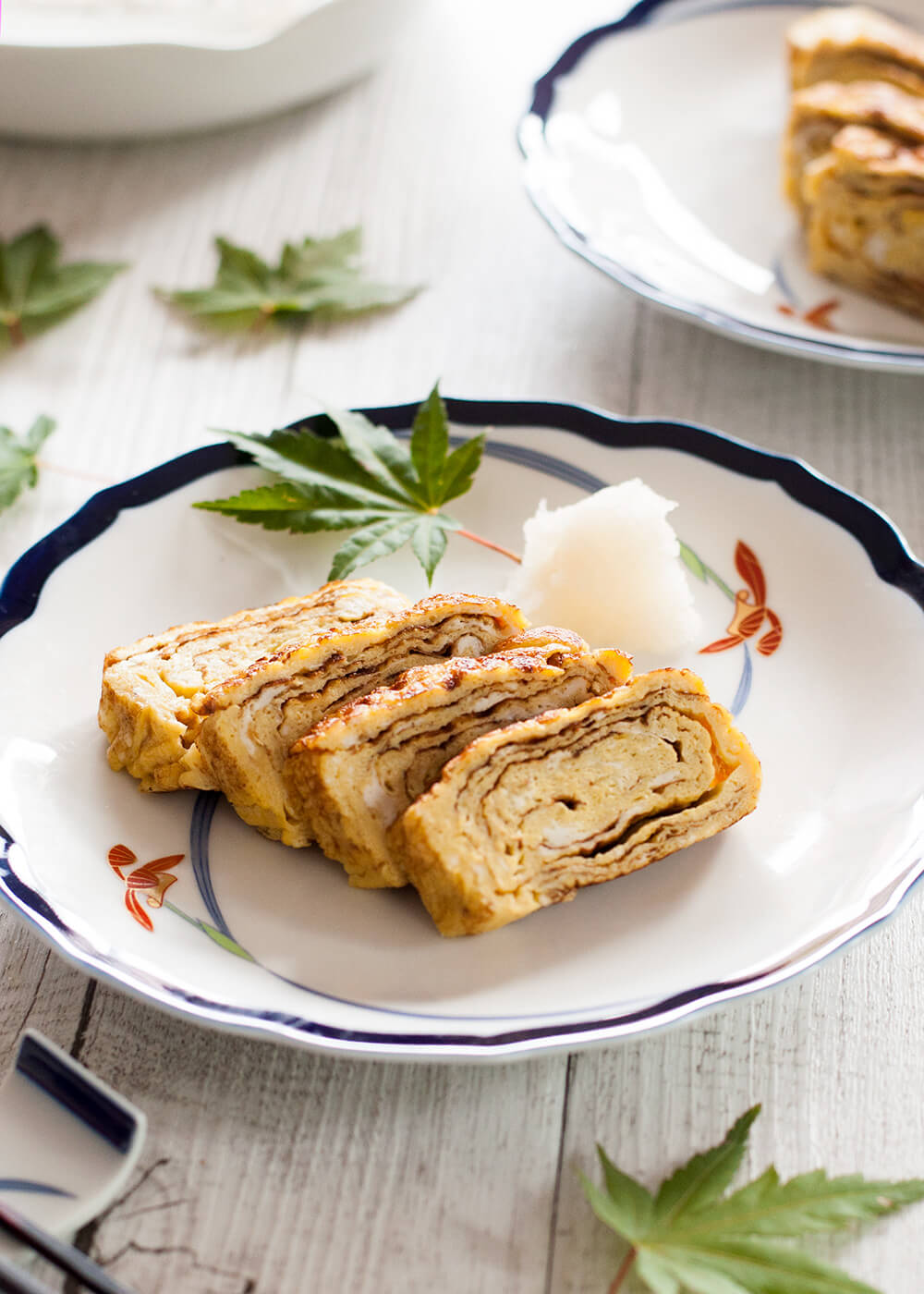 The typical egg dish in Japanese cuisine, dashimaki tamago (出し巻き卵, Japanese rolled omelette) is made by rolling thin layers of egg in the frypan. The beautiful layers of the egg when sliced, and the sweet dashi flavour make this omelette so unique.