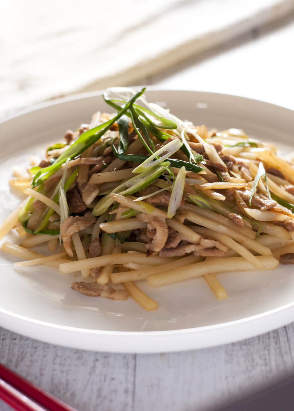 You will be surprised to learn that the texture of potatoes when quickly stir fried is so unique and different from the cooked potatoes you know. Pork and potato stir fry turns the potatoes into something totally different from the usual dishes like baked potatoes, potato salads and mashed potatoes. And it is so quick to make and yummy.