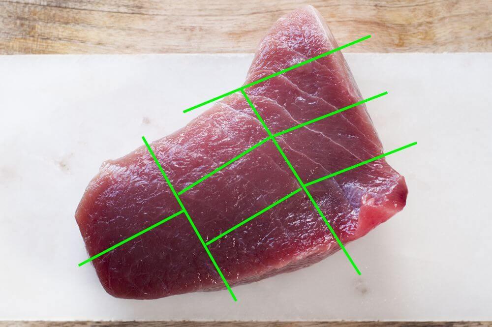 Cutting large block of tuna to sashimi.