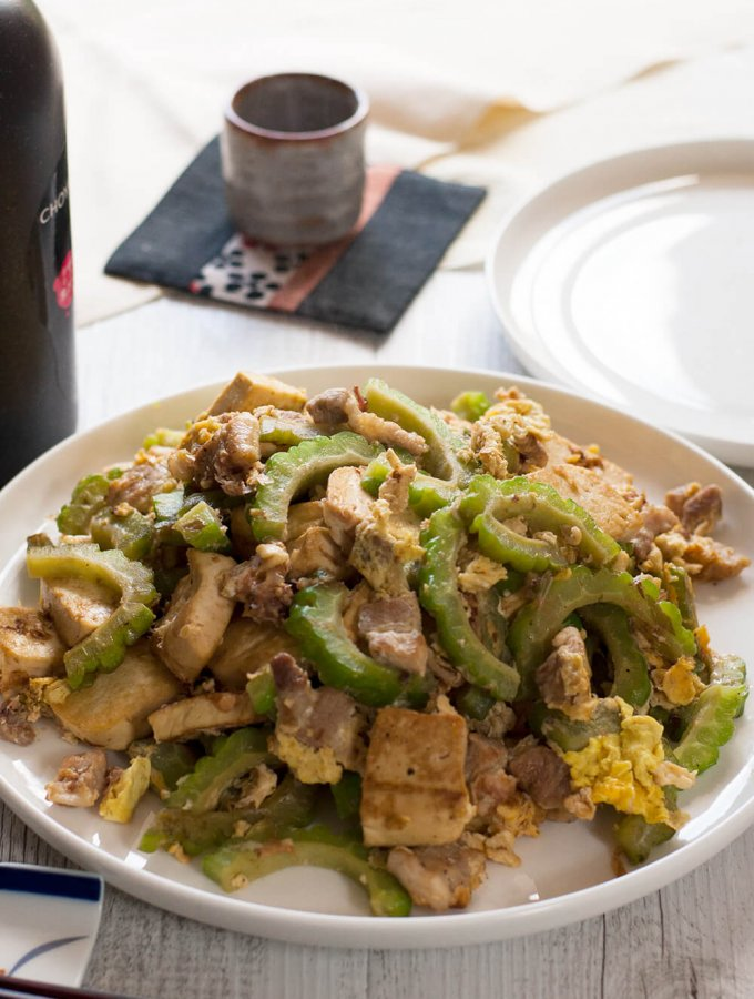 A super easy Japanese stir fry from Okinawa, goya chanpuru is full of bonito flakes, which is unique for a stir fry dish and so flavoursome that you will get addicted to it. It is not greasy at all and my version is made with pork slices instead of SPAM which is the real version of goya chanpuru.