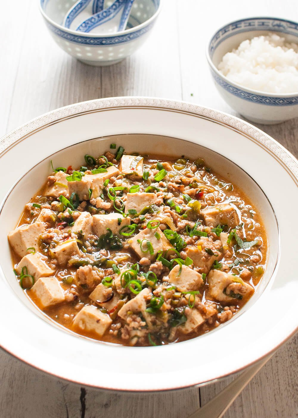 """Mabodofu (麻婆豆腐) is the Japanese name for """"Mapo Tofu"""", which is a Chinese dish from Sichuan province. Tofu and ground meat are stir fried with a flavoursome sauce. But the flavour of mabodofu is yet again modified to suit to the Japanese palette and not as spicy as the Chinese version of mapo tofu."""
