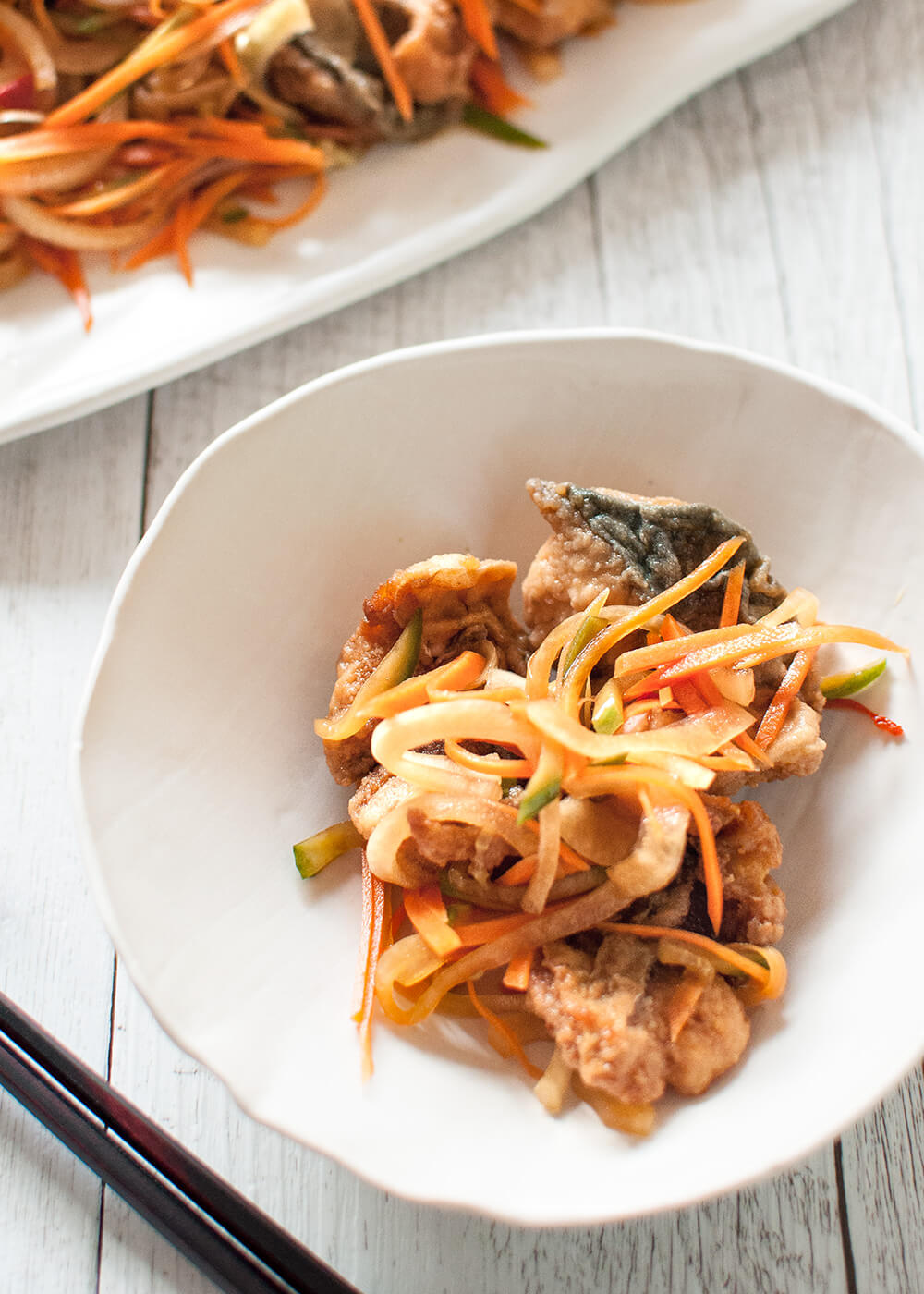 When bite size pieces of deep fried fish are marinated in slightly sweet vinegar and soy based sauce with plenty of shredded vegetables, it transforms the fish into something totally different.