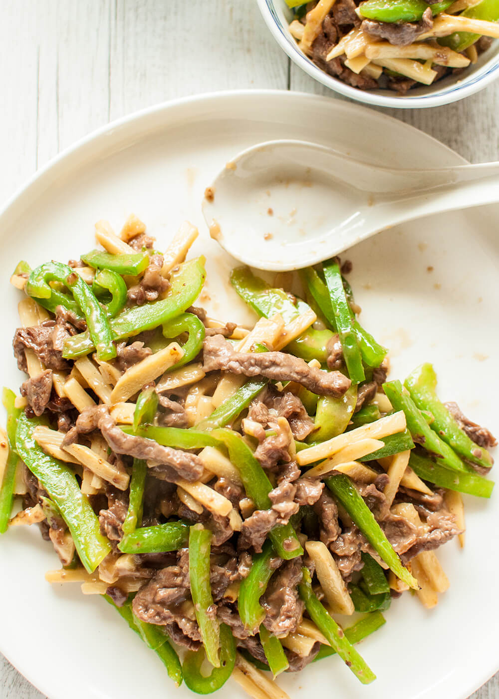 This is a quick stir fry dish that originated in China. Beef, green pepper (capsicum) and bamboo shoots are cut into thin strips and cooked in soy flavoured sauce with a touch of oyster sauce.