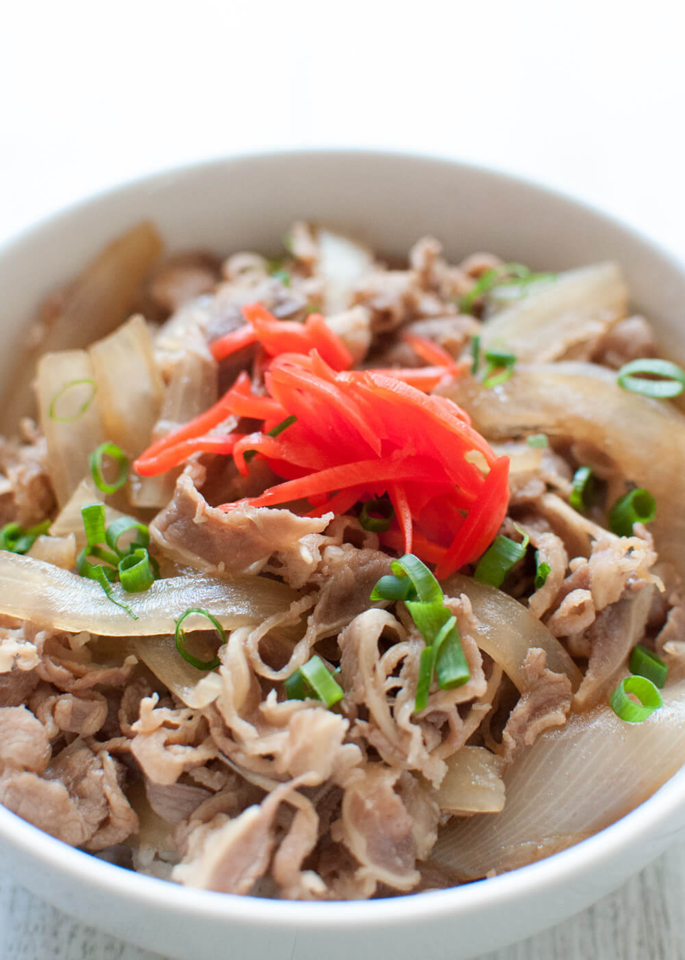 Japanese Beef bowl (Gyū-don) is a popular one-bowl dishthat consists of a bowl of rice topped with thinly sliced beef and onions simmered in sweet soy-flavoured sauce. It is so quick to make, tasty and filling – a perfect mid-week family meal.