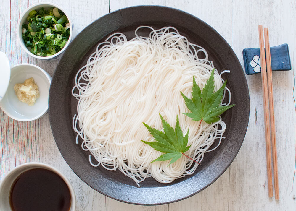 Somen (or sōmen) is a very thin noodles served cold which makes it a perfect summer dish. Noodles are served in chilled water and the dipping sauce is also chilled.
