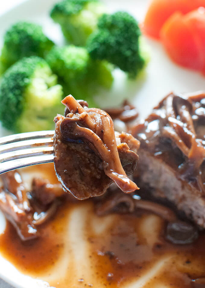 Ready to eat a mouthful of Nikomi Hamburg Steak on the fork.