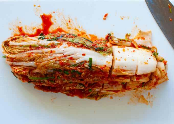 "to serve kimchi, cut the marinated Chinese cabbage leaves to 4cm/1½"" long crosswise."