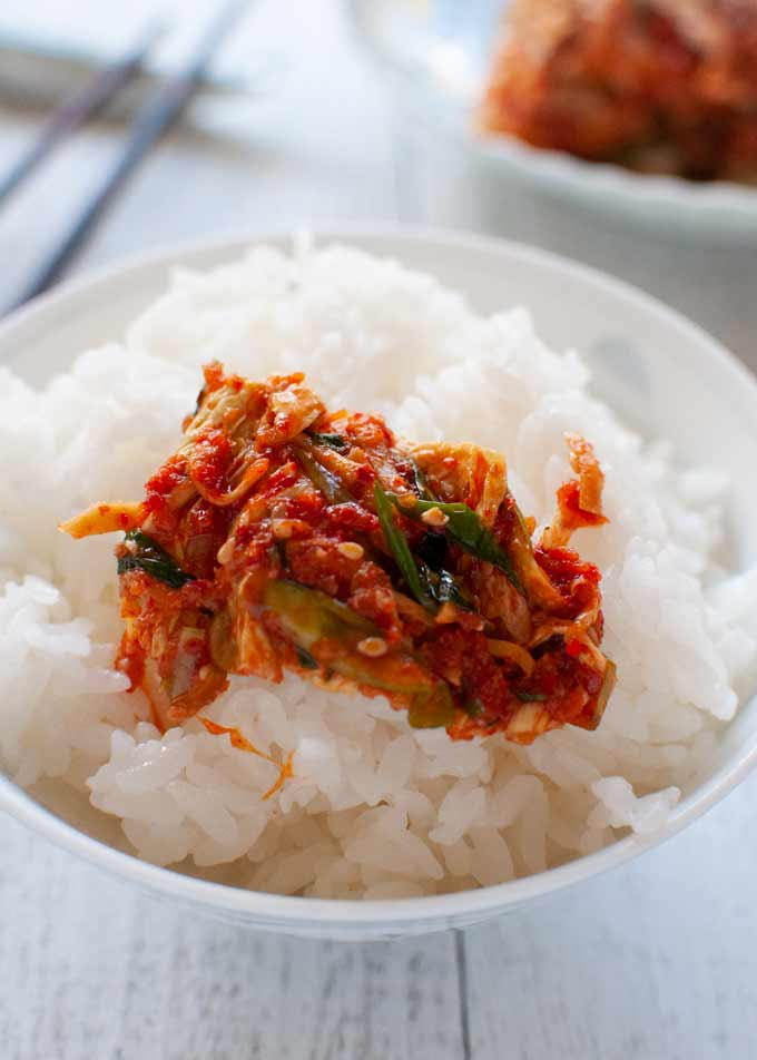Kimchi on a bowl of rice.