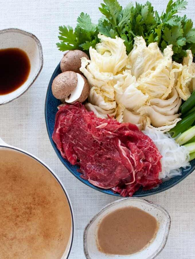 Shabu-shabu served with two dipping sauces.