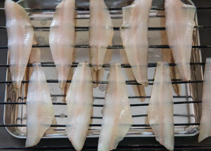 Semi Dried Whiting Fillets on a rack.