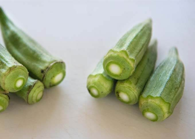 Trimmed okra - before and after.