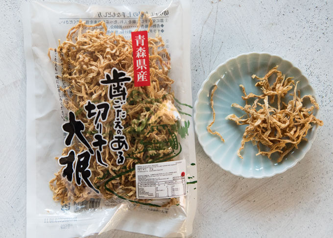 Kiriboshi Daikon in a pack and some pieces on a small plate.