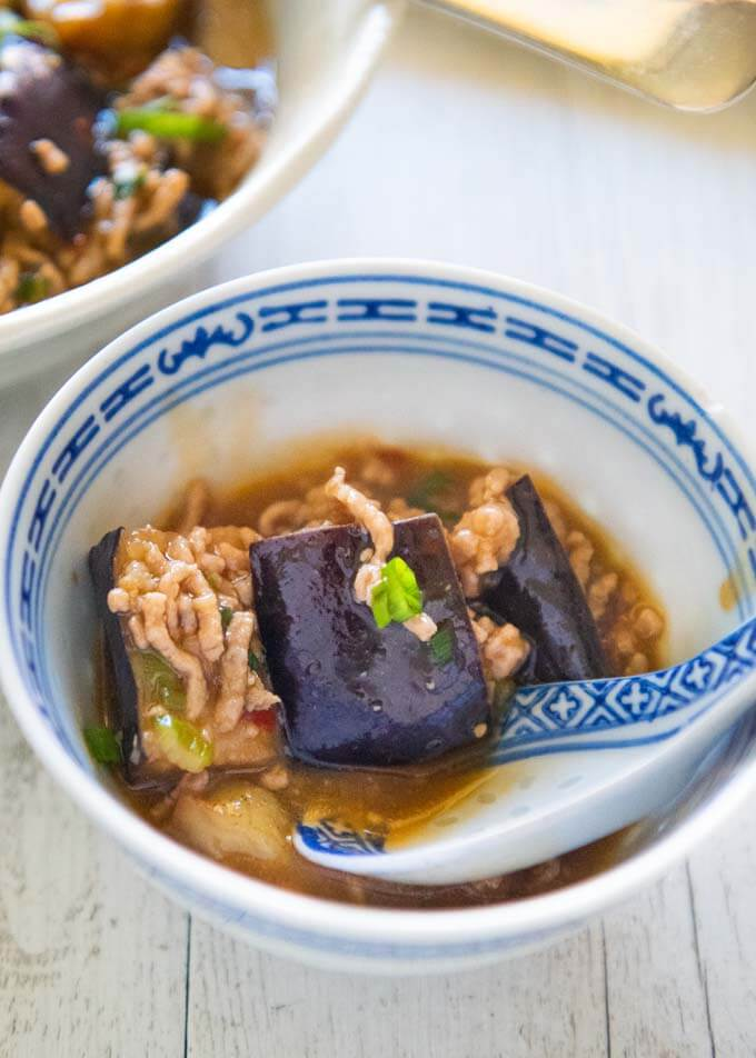 Zoomed-in photo of Eggplant with Minced Pork (Mābō Eggplant) served in a small bowl.