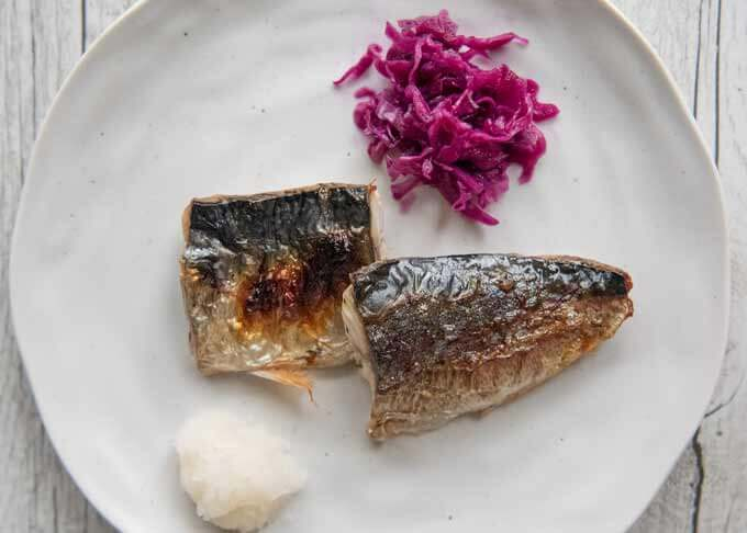 Pickled Red Cabbage is placed next to the grilled mackerel as a garnish.