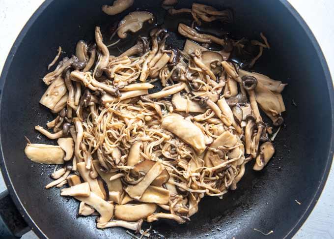 Sautéed mushrooms in a frying pan.