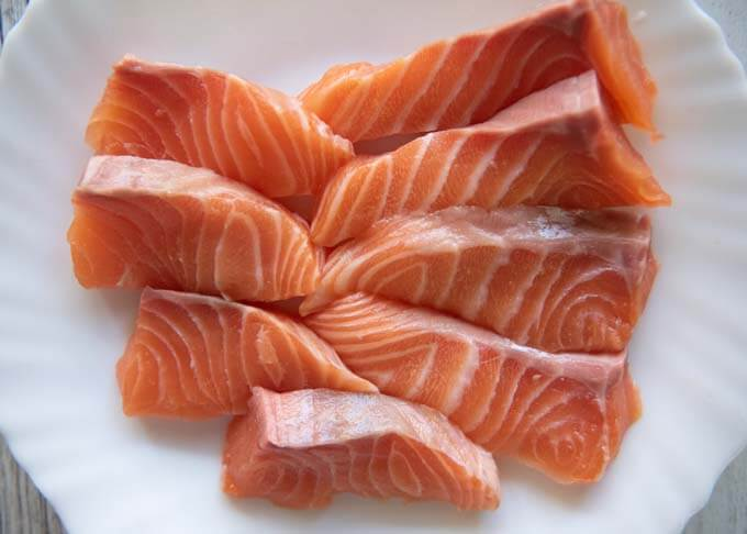 Salmon fillets cut to a large bite size.