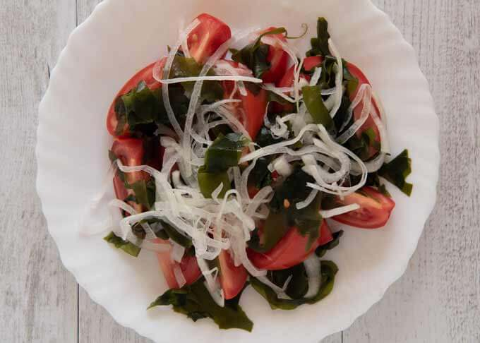 Top-down photo of Tomato and Seaweed Salad before adding the dressing.