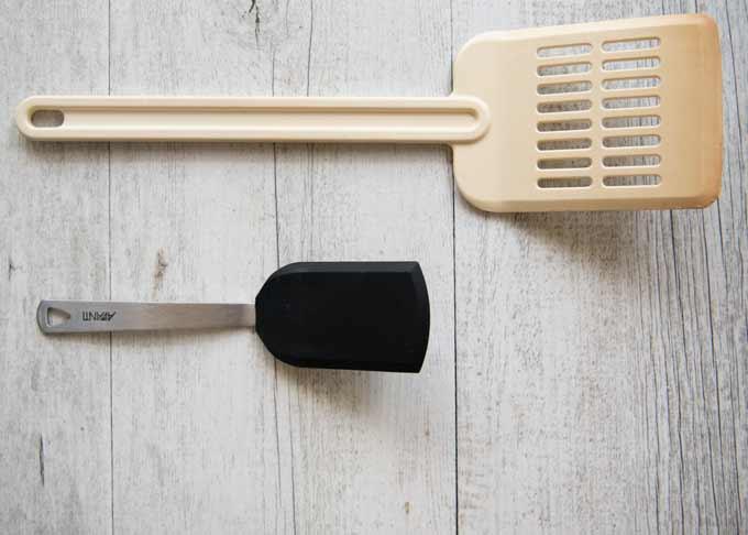 A standard-size spatula and a small spatula.