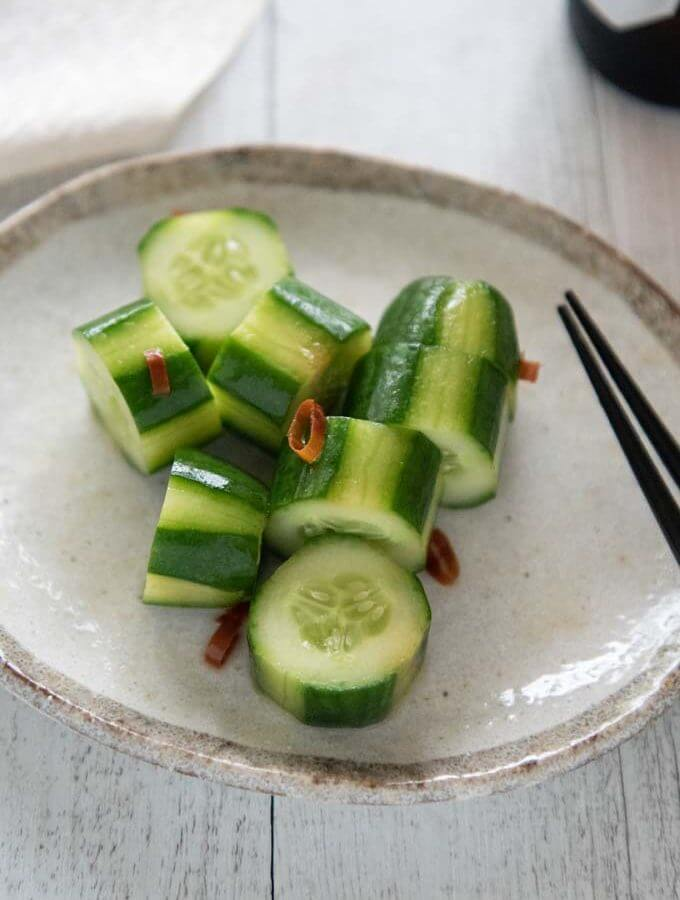 Shiro Dashi Pickled Cucumbers served on a plate.