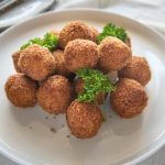 Hero shot of Pumpkin Croquettes piled on a plate.
