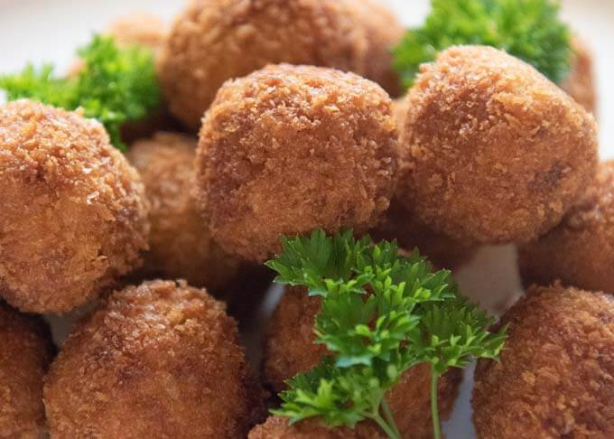 Zoomed-in photo of piled pumpkin croquettes.