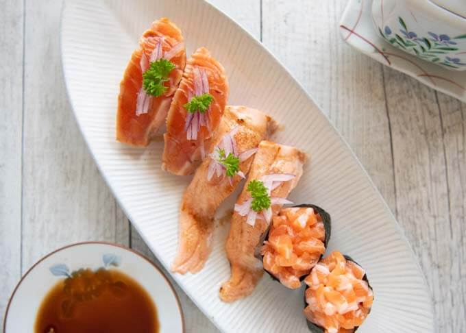 Three different ways of serving salmon sushi - Aburi salmon two wasy + gunkan salmon sushi.