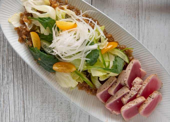 Top-down photo of Tuna Sashimi salad.