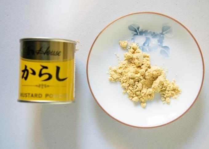 Showing Japanese mustard, Karashi in powdered form and a little tin of the karashi powder.