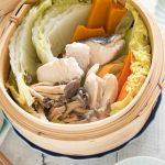 Hero shot of Steamed Chicken and Fish with Vegetables.