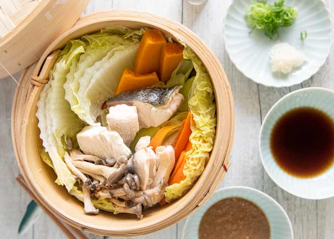Top-down photo of Steamed Chicken and Fish with Vegetables.
