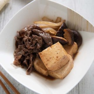Hero shot of Simmered Beef and Tofu (Niku Dōfu) served in a bowl.