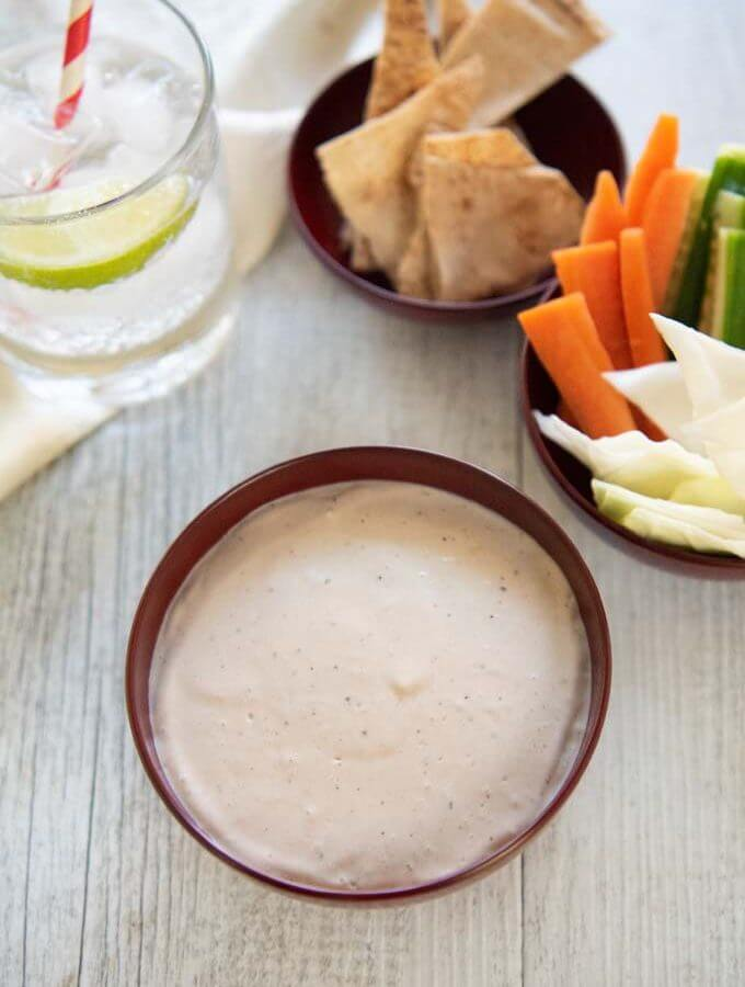 Hero shot of Anchovy and Tofu dip served with vegetables and crisps.