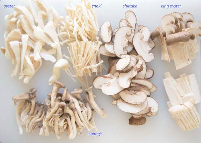 5 kinds of Asian mushrooms, sliced to similar sizes.