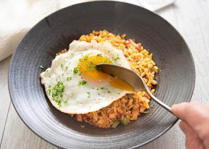 Breaking the egg yolk on Japanese Curry Fried Rice.