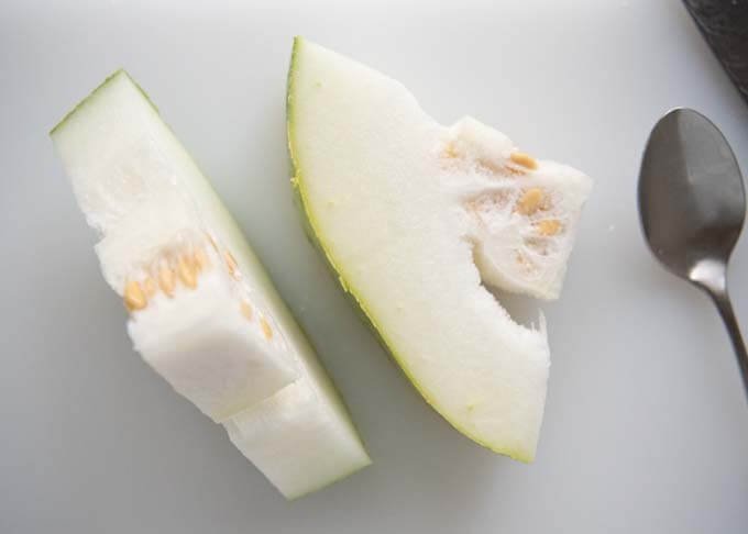 Sliced winter melon showing seeds and soft fluffy flesh.